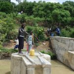 The Water Project: Mbiuni Community A -  Filling Container With Water