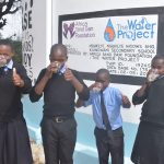 The Water Project: Kiundwani Secondary School -  Drinking Water From The Tank
