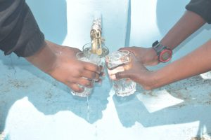 The Water Project:  Filling Up Glasses With Water At The Tank