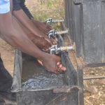 The Water Project: Kiundwani Secondary School -  Using New Handwashing Station
