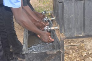 The Water Project:  Using New Handwashing Station