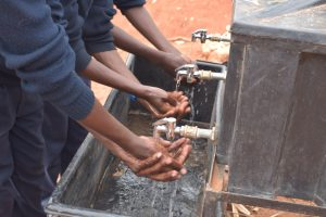 The Water Project:  Using The New Handwashing Station