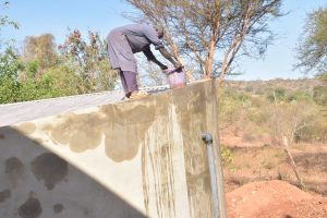 The Water Project:  Wetting Cement To Help Cure