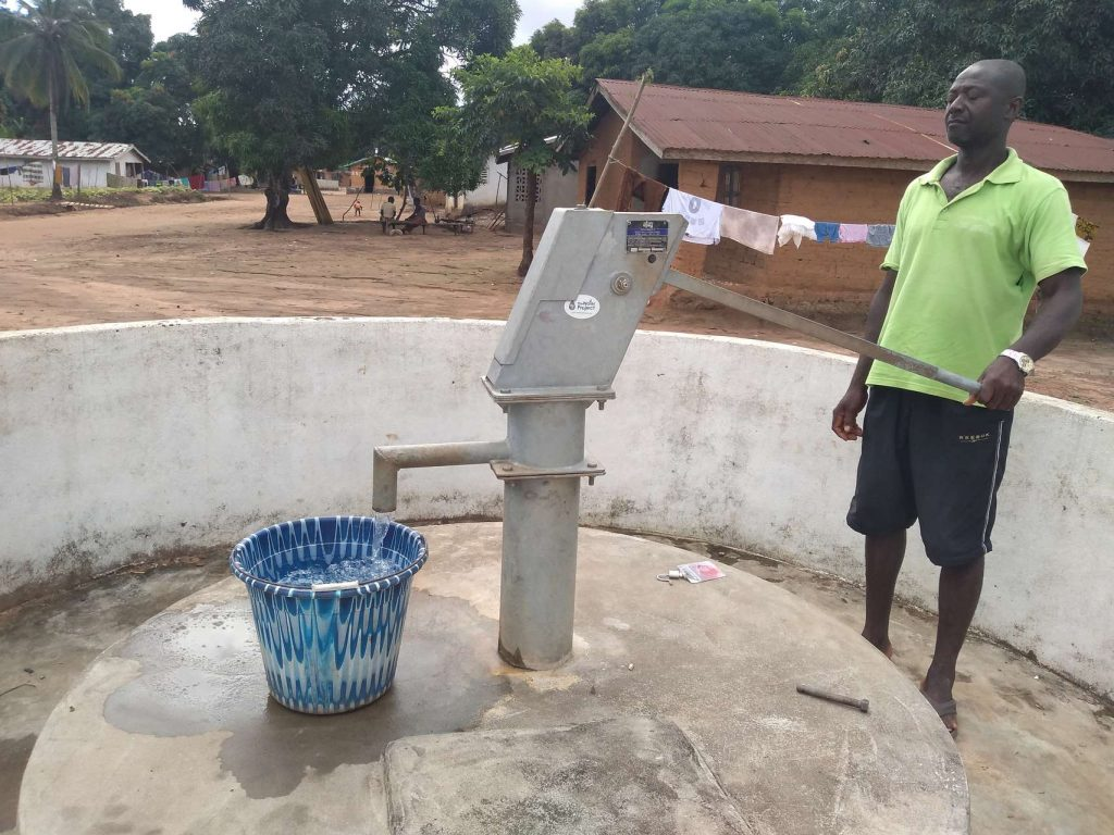 The Water Project : sierraleone18268-filling-up-container-a-year-later