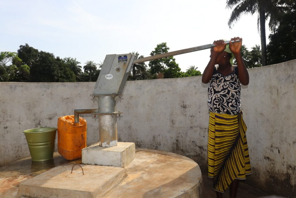 The Water Project : sierraleone18270-community-member-using-water-source