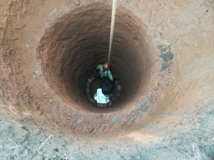 The Water Project:  Digging Out Well