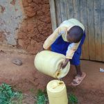 The Water Project: Boyani Primary School -  Student Collecting Water At Home