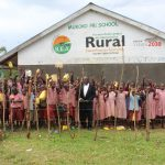 The Water Project: Mukoko Baptist Primary School -  Students And Staff Pose With Their School Mural