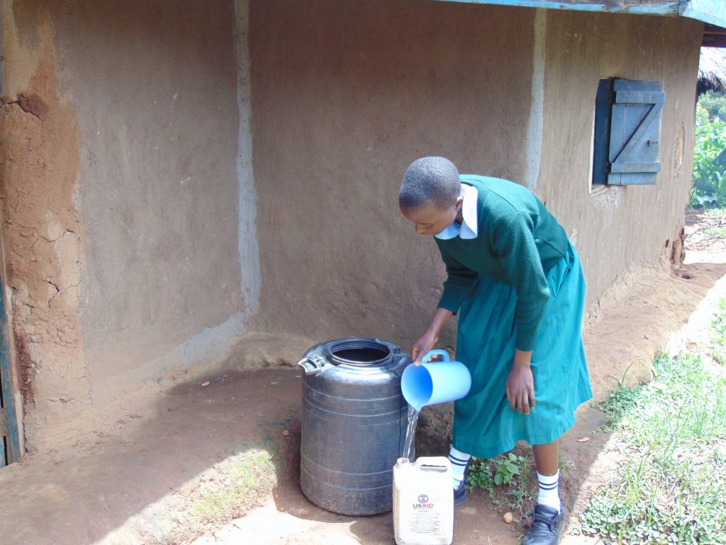 The Water Project : 0-kenya20131-student-fetching-water-from-home-before-school