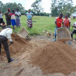 The Water Project: Gimariani Secondary School -  Students And Community Members Help Deliver Materials