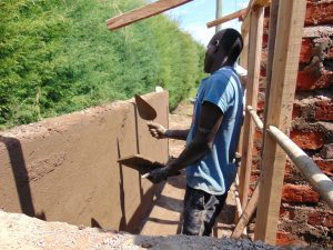 The Water Project:  Cementing Latrine Entryway Walls