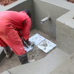 The Water Project: Shisere Community, Richard Okanga Spring -  Tile Setting