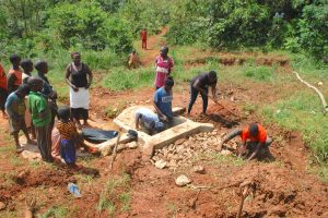 The Water Project:  Community Helping In Backfilling