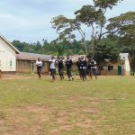 The Water Project: Kinu Friends Secondary School -  Girls Running To Their Latrines During Break