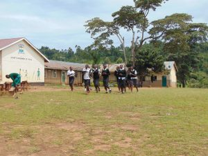 The Water Project:  Girls Running To Their Latrines During Break