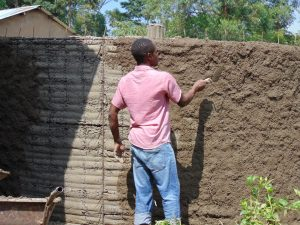 The Water Project:  Adding Outer Rain Tank Wall Cement