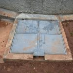 The Water Project: Friends School Mutaho Primary -  Manhole Cover With Lock Over Rain Tank Tap