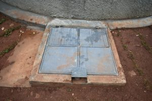 The Water Project:  Manhole Cover With Lock Over Rain Tank Tap