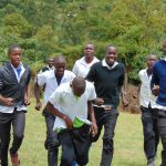 The Water Project: Kinu Friends Secondary School -  Boys Running To Their Latrines During Break