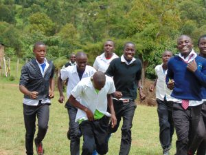 The Water Project:  Boys Running To Their Latrines During Break