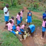 The Water Project: Gidimo Primary School -  Kenya Fetching Water From The Spring