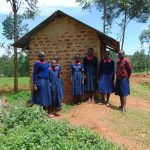 The Water Project: Jinjini Friends Primary School -  Girls Outside Their Latrines