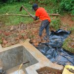 The Water Project: Shisere Community, Richard Okanga Spring -  Soil And Palstic Tarp Backfilling