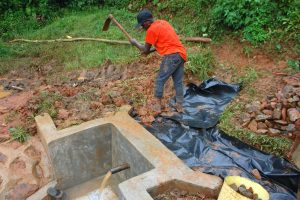 The Water Project:  Soil And Palstic Tarp Backfilling