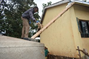 The Water Project:  Field Officer Clearing The Gutters Of Leaves