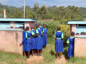 The Water Project:  Girls Line Up At Their Pit Latrines