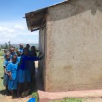 The Water Project: St. Michael Mukongolo Primary School -  Girls Line Up At Their Latrines