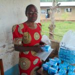 The Water Project: Lwombei Primary School -  Senior Teacher Phinora Khanali Unpacking Feminine Hygiene Towels For Students