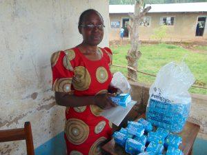 The Water Project:  Senior Teacher Phinora Khanali Unpacking Feminine Hygiene Towels For Students