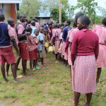 The Water Project: Mukoko Baptist Primary School -  Students Lined Up At The Only Two Latrines