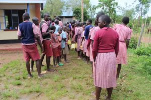 The Water Project:  Students Lined Up At The Only Two Latrines