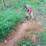 The Water Project: Bumavi Community, Joseph Njajula Spring -  Digging The Cutoff Drainage