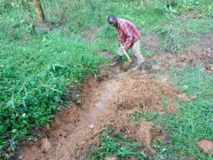 The Water Project:  Digging The Cutoff Drainage