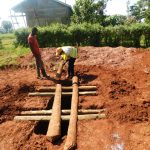 The Water Project: Friends School Mutaho Primary -  Laying Timber Over Latrine Pits