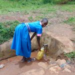 The Water Project: Gidimo Primary School -  Collecting Water