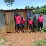 The Water Project: Jinjini Friends Primary School -  Boys Outside Their Latrines