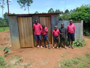 The Water Project:  Boys Outside Their Latrines