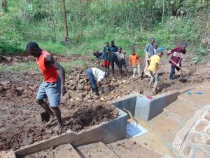 The Water Project:  Community Helps Out In Backfilling
