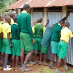 The Water Project: Gamalenga Primary School -  Boys Lined Up At The Latrines