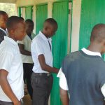 The Water Project: Kinu Friends Secondary School -  Boys Waiting To Use The Latrines