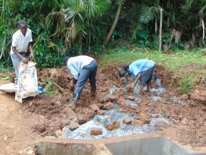 The Water Project:  Backfilling With Rocks And Soil
