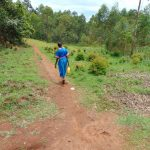 The Water Project: Gidimo Primary School -  Carrying Water