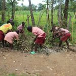 The Water Project: Mukoko Baptist Primary School -  Students Sweep Trash Into The Disposal Point