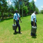 The Water Project: Friends School Vashele Secondary -  Students Carrying Water