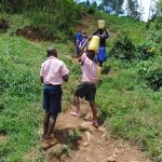 The Water Project: Bulukhombe Primary School -  Students Carrying Water Back To School