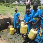 The Water Project: St. Michael Mukongolo Primary School -  Students Collecting Water